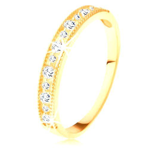 Ligotavý prsteň v žltom 14K zlate - línia čírych zirkónov s vrúbkovaným lemom - Veľkosť: 59 mm