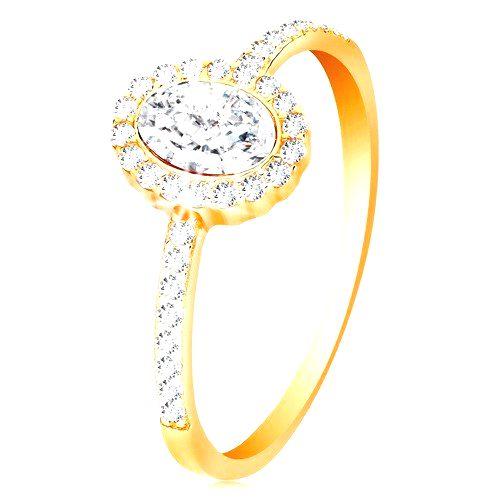 Prsteň zo žltého 14K zlata - oválny zirkón s ligotavým lemom