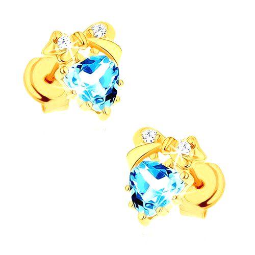 Zlaté náušnice 375 - modré topásové srdiečko s mašličkou