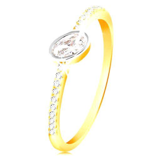 Zlatý prsteň 585 - číry oválny zirkón v objímke z bieleho zlata
