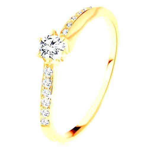 Zlatý prsteň 585 - zvlnené zirkónové ramená